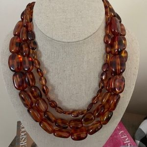 Express tortoise shell necklace.